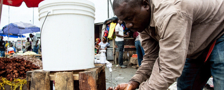 In this file photo taken on April 16, 2020, a man washes his hands with chlorinated water at the Mabibo market in Dar es Salaam, Tanzania. The late Tanzanian President John Magufuli then called on citizens to turn to God and to keep the economy turning, but as coronavirus cases kept going up, calls were rising for the country to take stronger action. Picture: Ericky Boniphace / AFP