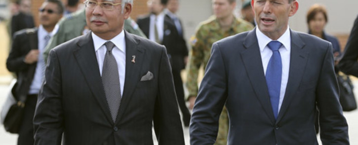 FILE: Malaysia Prime Minister Najib Razak walks with Australia's Prime Minister Tony Abbott on their way to meet crew members involved in the search of missing Malaysia Airlines flight MH370 at Pearce Airbase in Bullsbrook on 3 April, 2014. Picture: AFP.