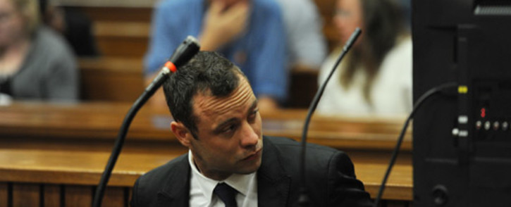 Oscar Pistorius in the dock after arriving at the High Court in Pretoria on the fourth day of his murder trial on 6 March 2014. Picture: Pool.