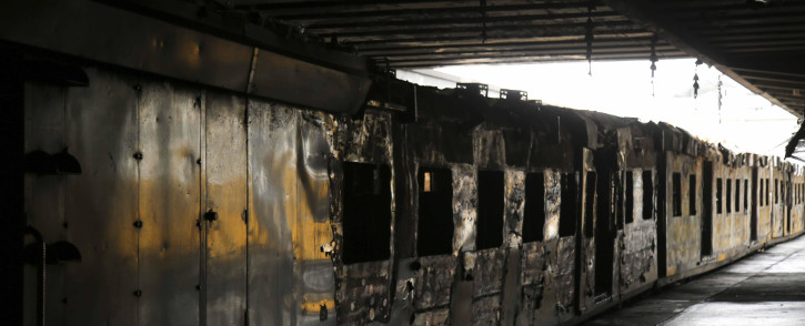 FILE: A train coach torched by angry commuters at CT Station. Untu-aligned train drivers refuse to work on the central line. Metrorail has described this line as the most dangerous route in the province. Picture: Cindy Archillies/EWN
