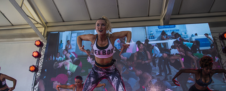 Fitness instructor Caley Jäck conducts a fit, fun and fearless workout session. Picture: Kayleen Morgan/EWN