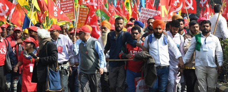 Indian farmers take part in a march organised by the All India Kisan Sabha (AIKS) organization and Communist Party of India (Marxist) alongwith other leftist groups, as they call for pro-farmer legislation in the Indian parliament, in New Delhi on 30 November 2018. Picture: AFP