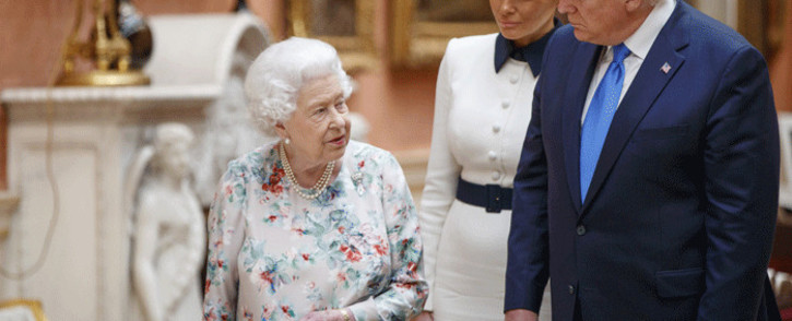Britain's Queen Elizabeth II (L), US President Donald Trump (R) and US First Lady Melania Trump (C) view displays of US items of the Royal collection at Buckingham Palace in central London on 3 June 2019, on the first day of their three-day state visit to the UK. Picture: AFP.