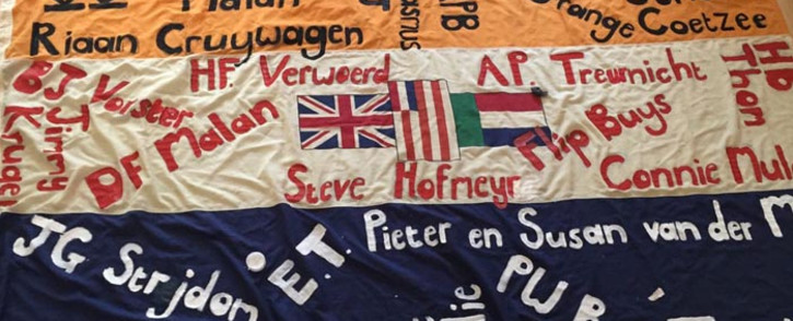 FILE: The old South African flag with the names of people that activist Johan Pienaar says were the architects and enablers of apartheid. Picture: @JohanPienaar/Twitter.