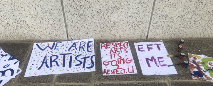 Placards seen at protest art performances outside the Artscape Theatre in Cape Town on 27 March 2021. Picture: Lizell Persens/Eyewitness News