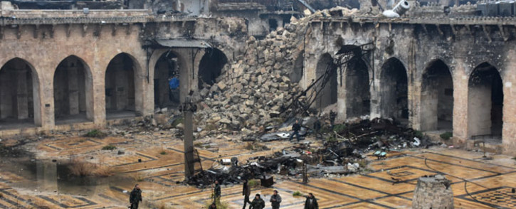 FILE: A general view shows Syrian pro-government forces walking in the ancient Umayyad mosque in the old city of Aleppo on 13 December 2016, after they captured the area. Picture: AFP