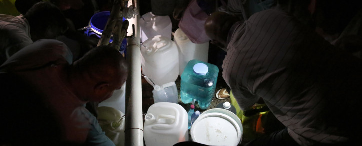FILE: Cape Town residents fill up their containers with water as they scramble to stock up before Day Zero. Picture: Bertram Malgas/EWN.