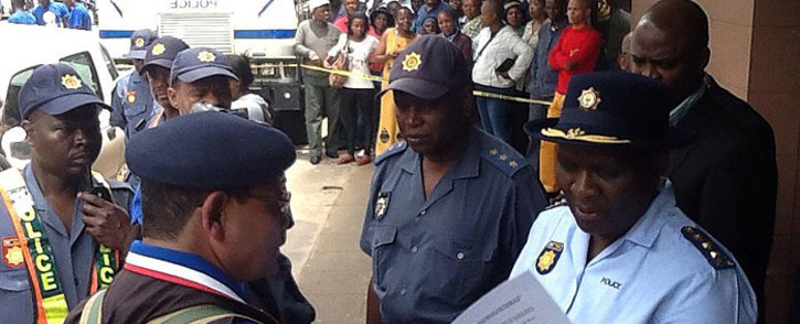 National Police Commissioner, Riah Phiyega receives a memorandum from concerned members of community, citing crime as their major challenge in society. Picture: Mia Lindeque/EWN.