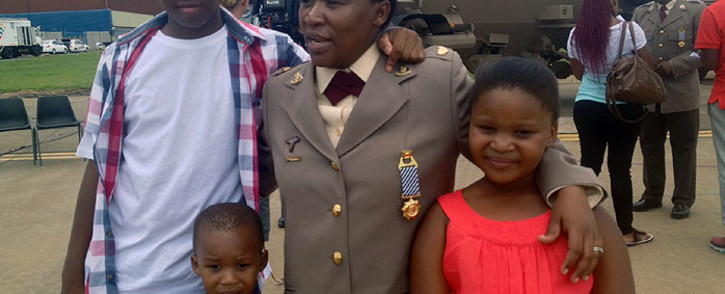 Nelson Mandela's military assigned personal doctor Doctor Motshidisi Sehotsane with her children after being awarded with the Nelson Mandela Medal in Pretoria. Picture Govan Whittles/EWN.