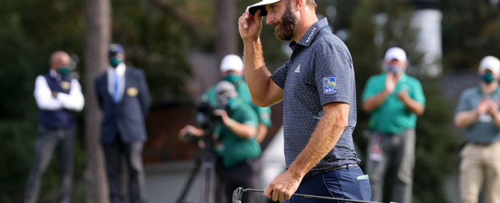 Dustin Johnson of the United States reacts on the 18th green after winning the Masters at Augusta National Golf Club on 15 November 2020 in Augusta, Georgia. Picture: AFP