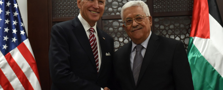 FILE: US Vice-president Joe Biden and Palestinian President Mahmud Abbas shake hands following a meeting at the presidential compound in the city of Ramallah, in the West Bank, on 9 March, 2016. Picture: AFP.