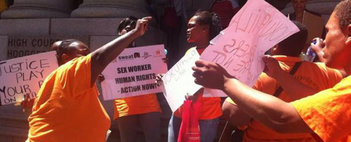 FILE: Sex Workers Education and Advocacy Taskforce (SWEAT) members gathered outside the Western Cape High Court today. Picture: Chanel September/EWN