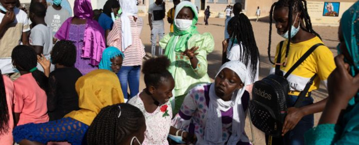 FILE: School students gather on their first day back at school in the popular Yoff neighbourhood in Dakar, Senegal, on 12 November 2020. Picture: JOHN WESSELS/AFP