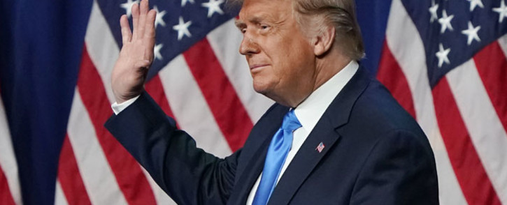 FILE: US President Donald Trump waves on the first day of the Republican National Convention at the Charlotte Convention Center on 24 August 2020 in Charlotte, North Carolina. Picture: AFP