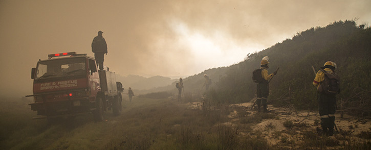 Firefighters battle fires that raged in Hawston in the Elgin Valley. Picture: Thomas Holder/EWN