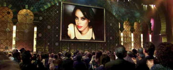 Members of the audience rise upon the appearance of an image of the late singer Aaliyah, who was posthumously awarded the Soul/R&B Favorite Female Artist at the 29th Annual American Music Awards 09 January 2002 in Los Angeles. Picture: AFP.