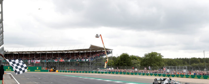 FILE: Mercedes driver Lewis Hamilton (R) crosses the line to win the British Formula One Grand Prix at the Silverstone motor racing circuit in Silverstone, central England, on 14 July 2019. Picture: AFP
