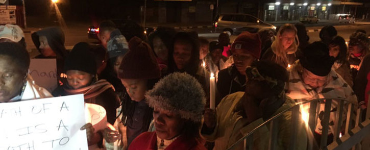 Women holding candles as they protest outside the Booysens Police Station. Picture: Katleho Sekhoto/EWN