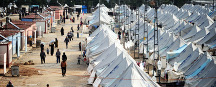 FILE: Syrian refugees walk among tents at Karkamis' refugee camp in January 2014 near the town of Gaziantep, south of Turkey. Picture: AFP.