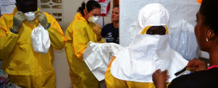 Staff of the Christian charity, Samaritan's Purse, puts on anti-Ebola protective gear in the ELWA hospital in the Liberian capital of Monrovia. Picture: AFP