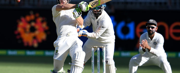Australia's batsman Tim Paine (L) plays a shot during day one of the second Test cricket match between Australia and India in Perth on 14 December 2018. Picture: AFP