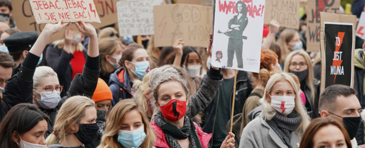 Demonstrators protest with banners and placards against tightening Poland's already restrictive abortion law in Warsaw on 28 October 2020. Picture: AFP.
