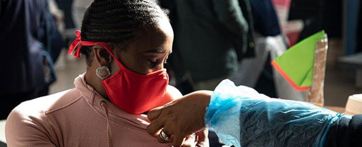 FILE: An Education Department employee gets a COVID-19 vaccine shot at the Rabasotho community hall in Tembisa on 23 June 2021. Picture: Xanderleigh Dookey Makhaza/Eyewitness News