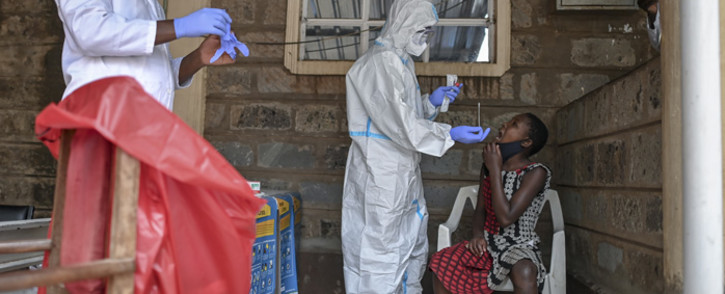 A young girl waits to be tested during mass testing for COVID-19 coronavirus provided free of charge by the Kenyan government in the Kibera slum in Nairobi, Kenya, on 18 October 2020. Picture: AFP.