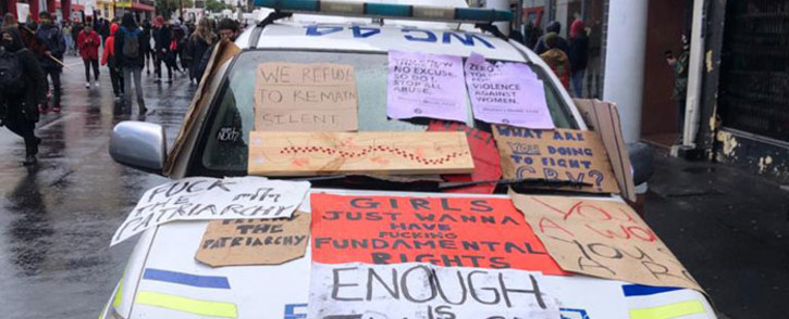 A police vehicle is covered with placards during an anti-gender-based violence protest in front of Parliament in Cape Town on 29 August 2020. Picture: Courtney Savage