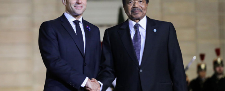 French President Emmanuel Macron greets Cameroon President Paul Biya prior to a dinner with the participants of the Paris Peace Forum at the Elysee Palace, in Paris, on 11 November 2019. Picture: AFP