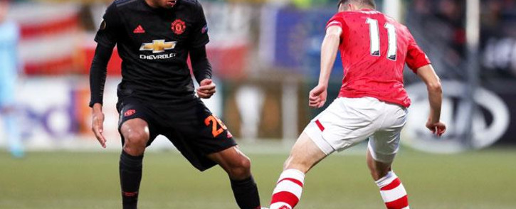 Manchester United's Mason Greenwood (left) tackles his AZ Alkmaar opponent in their UEFA Europa League match on 3 October 2019. Picture: @ManUtd/Twitter