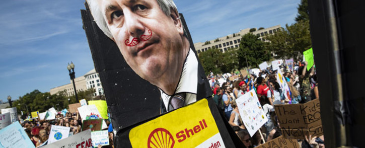 Youth carry along an effigy of Shell CEO Ben van Beurden for the Global Climate Strike protests on 20 September 2019 in Washington, DC. Picture: AFP