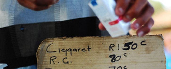 FILE: A vendor sells cigarettes on the side of the road in Alexandra township. Picture: EWN.