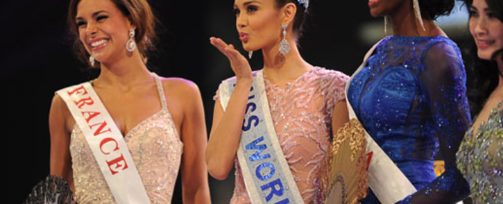 Miss Philippines, Megan Young (C) gives a gesture of flying kiss to audience after winning the new Miss World title over 126 beauty contestants in the Miss World 2013 finals in Nusa Dua, in Indonesia's resort island of Bali on 28 September 2013. Picture: AFP /ROMEO GACAD
