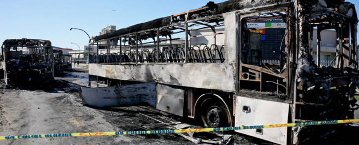 Torched Golden Arrow buses in Nyanga, Cape Town on Monday 1 September 2014. Picture: Sapa.