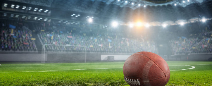 Rugby ball on field 123rf