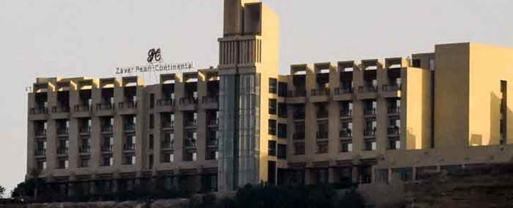 This picture taken on March 8, 2019 shows a general view of the five-star Zaver Pearl Continental hotel known as the Pearl Continental, located on a hill in the southwestern Pakistani city of Gwadar, where gunmen stormed the building. Picture: AFP.