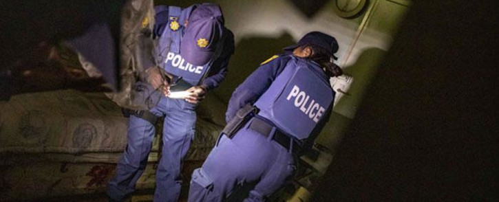 FILE: Police officers during raid. Picture: Thomas Holder/EWN