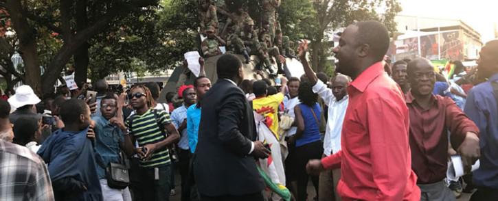 Scenes of jubilation as Zimbabweans head to the streets to celebrate Robert Mugabe's resignation as president. Picture: Ihsaan Haffajee/EWN.