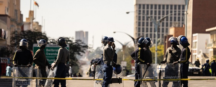 Police officers patrol near Tredgold Magistrates courts on 19 August 2019, in Bulawayo, Zimbabwe. Picture: AFP