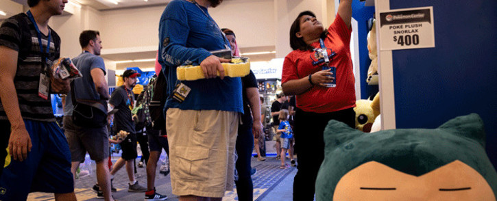 People peruse Pokemon products during the first day of the 2019 Pokemon World Championships at the Washington Convention Centre 16 August 2019, in Washington, DC. Picture: AFP