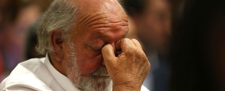 Barry Steenkamp, father of Reeva Steenkamp, reacts as judgment is handed down in the murder trial of Oscar Pistorius at the High Court in Pretoria on 12 September 2014. Picture: Pool.