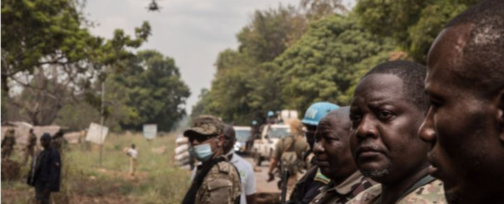 FILE: Central African Republic Prime Minister Firmin Ngrebada (2nd R), salutes his troops on the road between Boali and Bangui, on 10 January 2021. Picture: FLORENT VERGNES/AFP