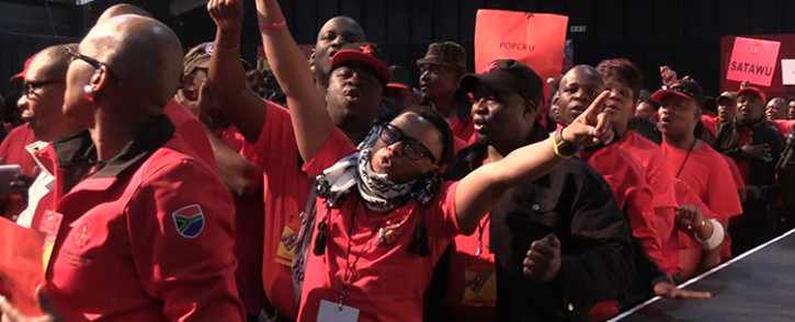 Cosatu members sing during the opening day of the union federation's two-day Special National Congress in Midrand. Picture: Vumani Mkhize/EWN.