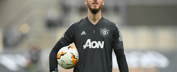 Manchester United goalkeeper David de Gea arrives to warm up ahead of the Europa League quarterfinal football match between Manchester United and Copenhagen at the RheinEnergieStadion stadium in Cologne on 10 August 2020. Picture: AFP