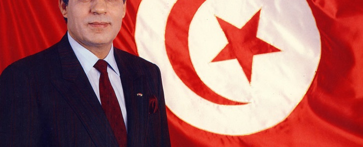 FILE: In this photo taken on 1 April 1988, former President Zine el-Abidine Ben Ali 1987 poses for an official picture in front of the Tunisian flag. Picture: AFP