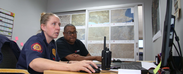 Law enforcement authorities at work in the Disaster Management Joint Operations Centre, keeping an eye on the fires in George. Picture: Bertram Malgas