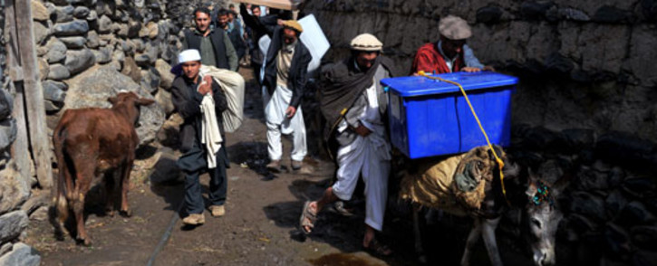 Villagers transport election materials on donkeys in the Dara-e-Noor district of Nangarhar province in Eastern Afghanistan on 4 April 2014. Picture: AFP.