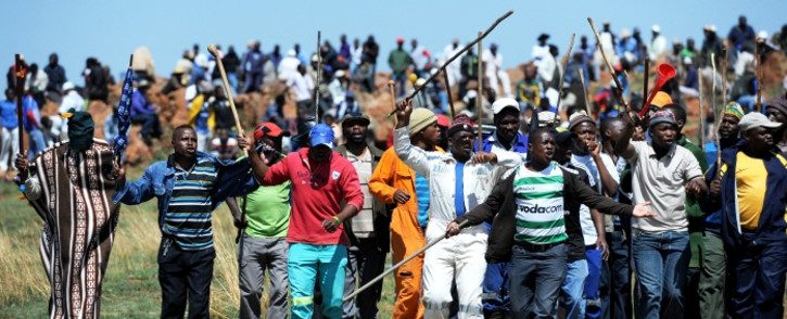 Striking Amcu members are demanding a basic R12,000 monthly salary. Picture: Sapa.