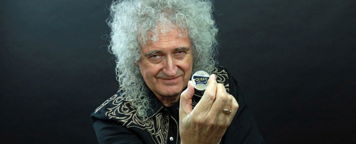Queen lead guitarist Brian May with the band's commemorative coin. Picture: @RoyalMintUK/Twitter